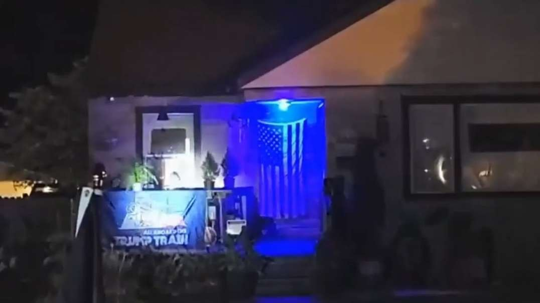 BLM protesters in Milwaukee, Wisc. surround a man's house. He has a Trump & US flag on the outside. He appears to ready a gun from inside the home. He was reportedly arrested for brandishing the weapon.