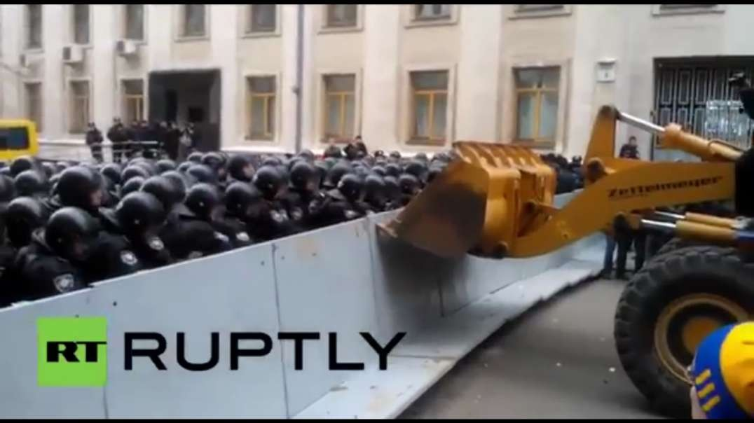 Ukrainian protestors know how to break through a police line. They steal a digger