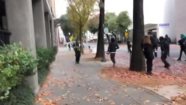 Antifa black bloc chased a man into an alley in Sacramento, Cal. and beat him with weapons yesterday. Their comrades tried to stop journalists from filming.