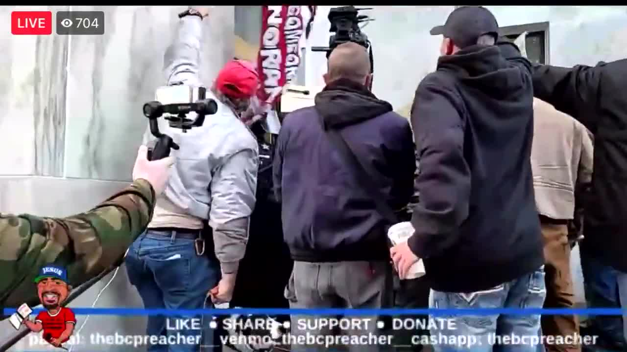 Crowd trying to force their way into the State Capital building in Oregon.happened a couple days ago