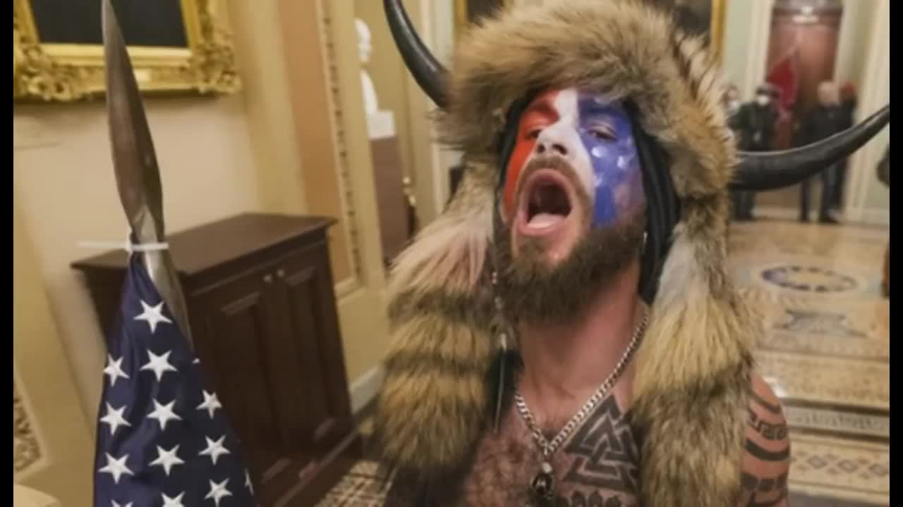 Horned Arizona Man Who Stormed Capitol, Via Getty are Both In Custody and Charged In Federal Court