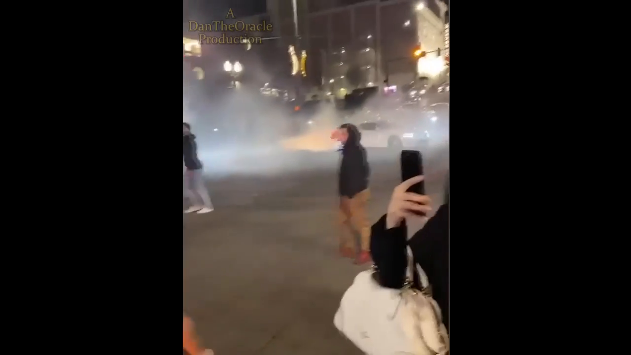 better footage of Tacoma police car plowing through crowd of pedestrians gathered at downtown street race