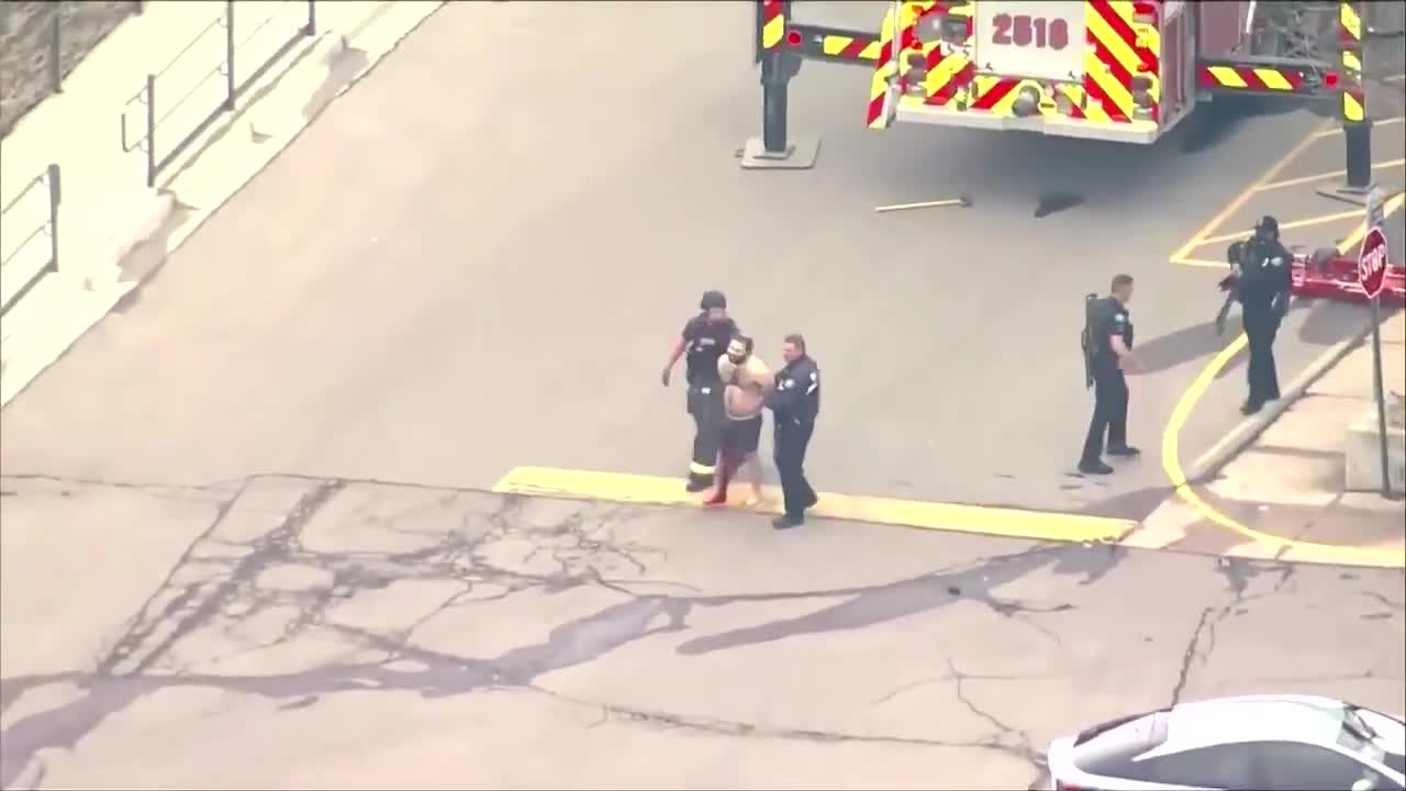 Police in Boulder, Colorado, reported an 'active shooter' at a King Soopers grocery store, and aerial footage broadcast live from the scene by local media showed one person being placed in an ambulance and a man in handcuffs