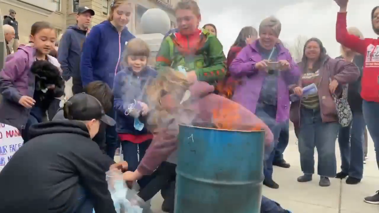 Families held a 'burn the mask' protest today on the steps of the capitol building