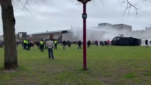 System agents in the Netherlands try to shoot anti-lockdown protesters with water cannons, but strong winds blow it back in their faces
