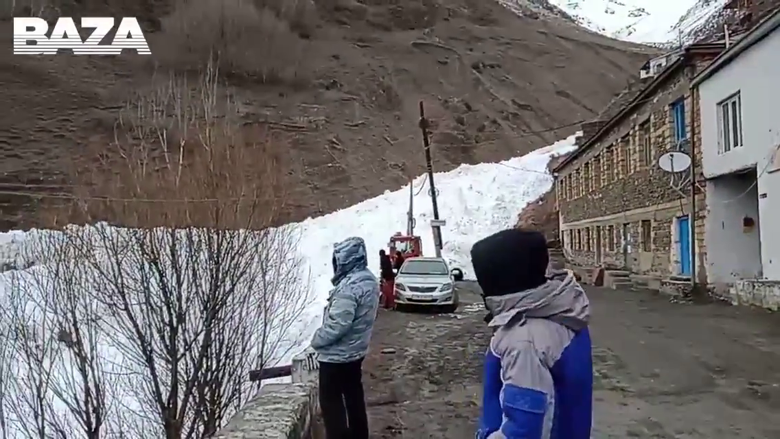 Russia- Residents of Tsakhur village stood by as an Avalanche run through their Town!