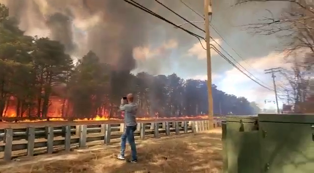 A large brush fire shut down a portion of the Garden State Parkway in Lakewood, New Jersey