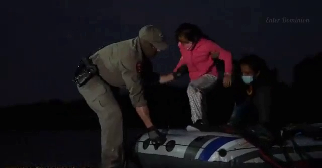 Border Patrol helps migrants off the boat and then goes after smuggler, puncturing the boat