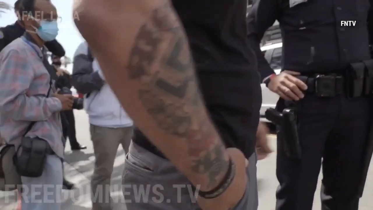 ⁣⁣ White Lives Matter vs filthy commies , fights breaking out and arrests made in ⁣Huntington Beach, California