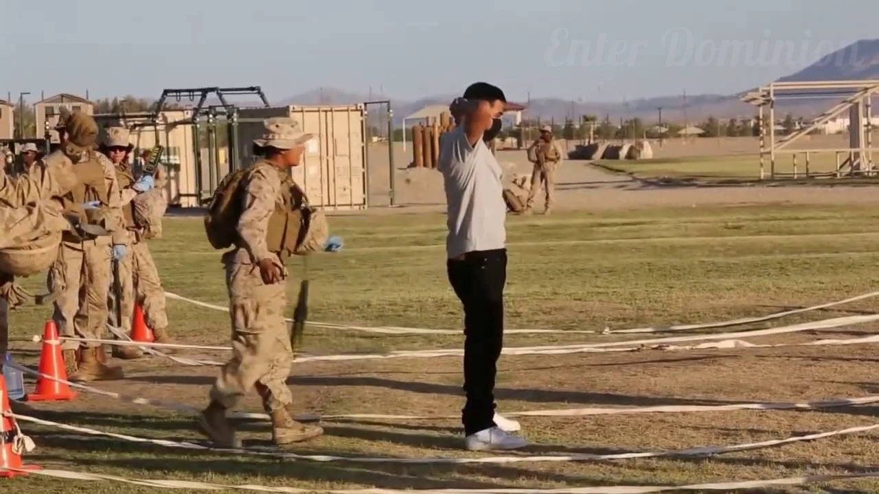 Marines training in Twentynine Palms. People in casual clothing being searched and detained. 4 16 21