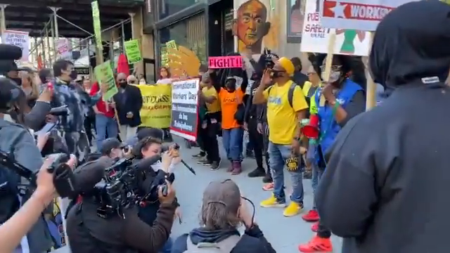 NY: May 1st march arrived at Jeff Bezos' apartment building at West 26th Street and 5th Avenue.