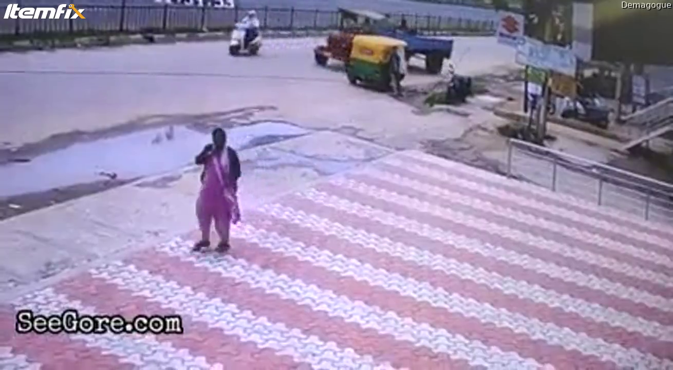 Man gets flung by wire then lady kindly breaks his fall