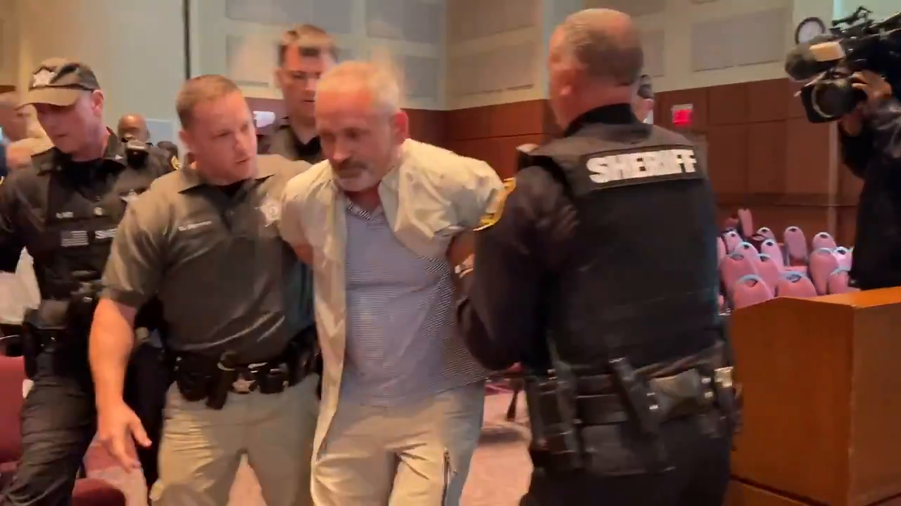 Two arrests made at a Virginia school board meeting after it was declared an unlawful assembly because parents protesting critical race theory and transgender policy refused to leave