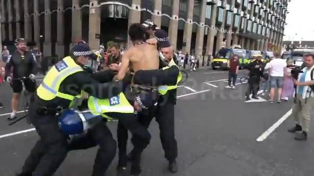 alt media journalist - is manhandled and thrown to the ground by UK Piggers