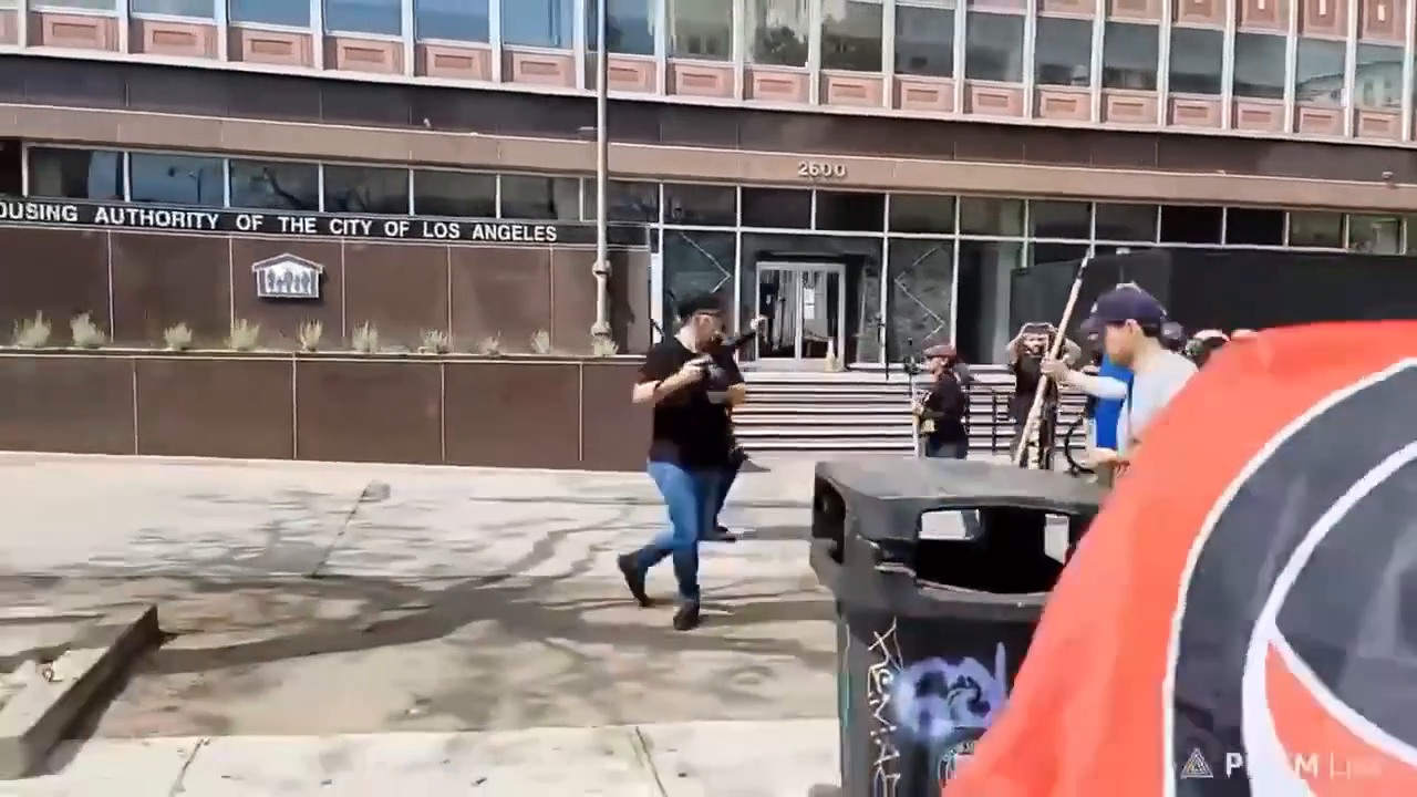 Antifa attacks another Christian demonstrator and surrounds woman who held a sign outside Wi Spa