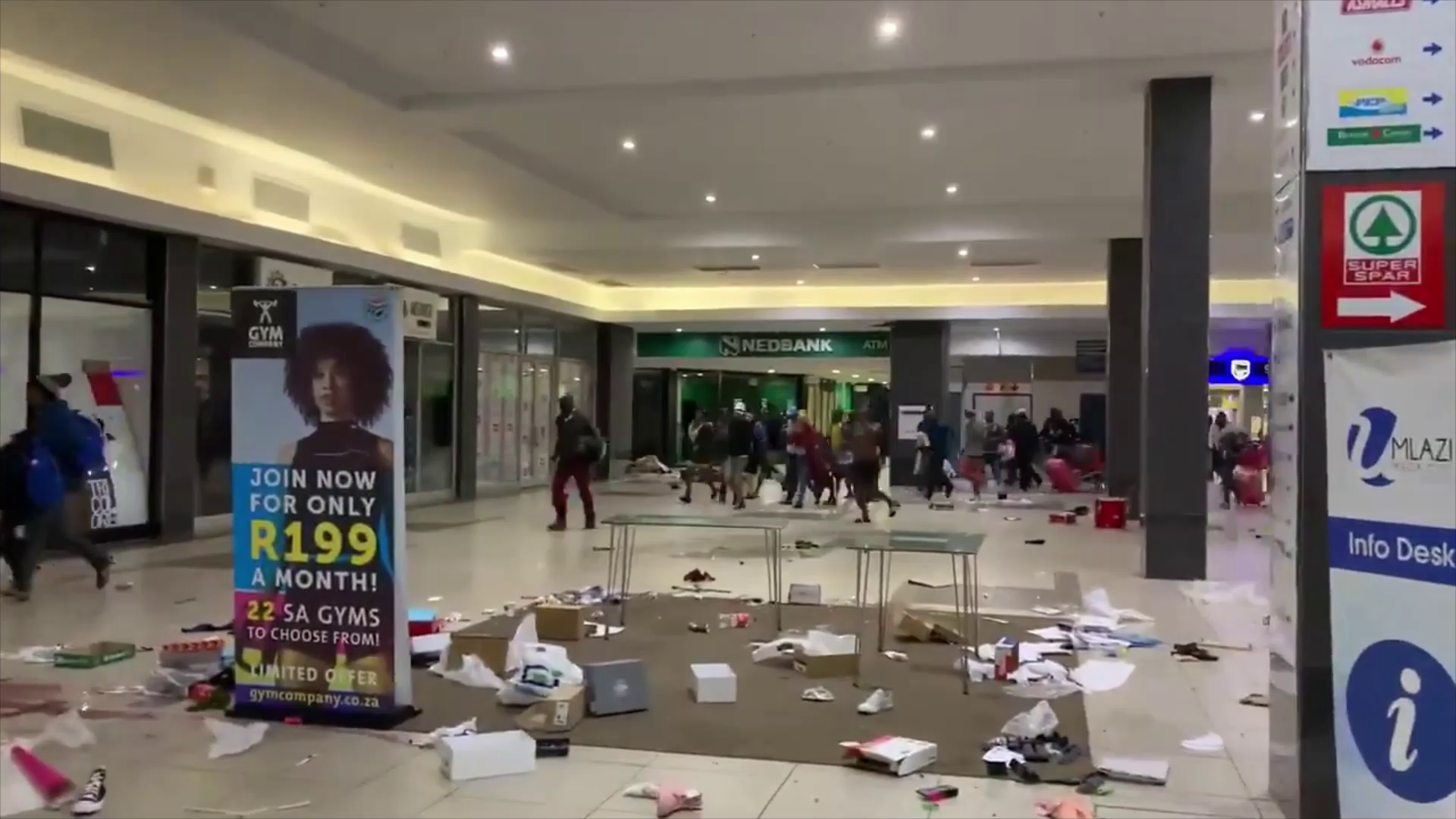 Footage of police attempting to curb looting inside a Durban mall and then robbing food themselves- The Future of the West