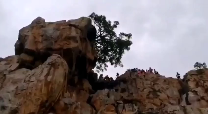 Andhra Pradesh, India. A 49-year-old priest falls off hillock while performing puja dies.