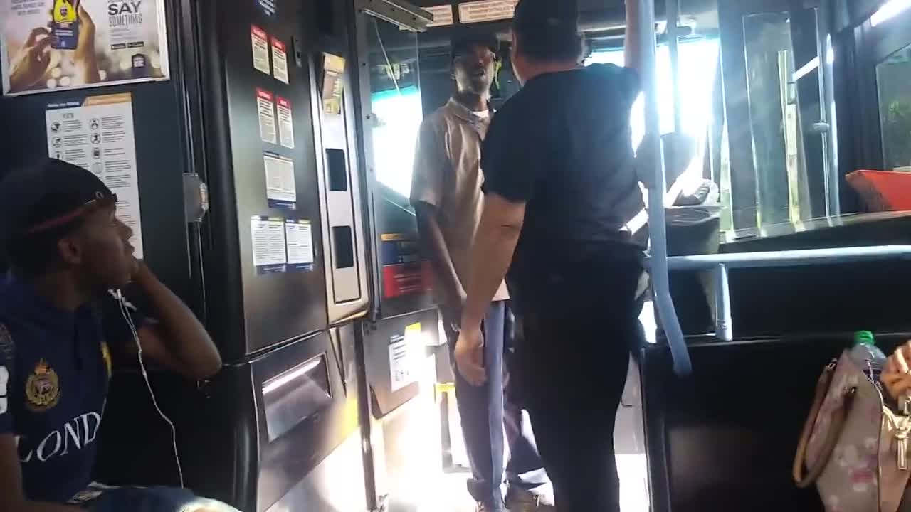 Retarded Apes harass a 60 year old man on the bus; Whitey stands his ground