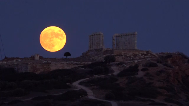 Full moon rising over the ancient temple of Poseidon in Sounion, Greece