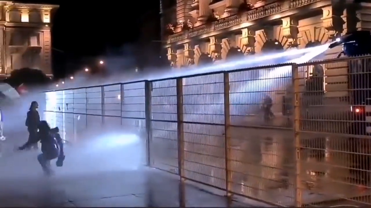 Protestors against Covid/Vaxx Passports getting hosed down by System officials in Switzerland.