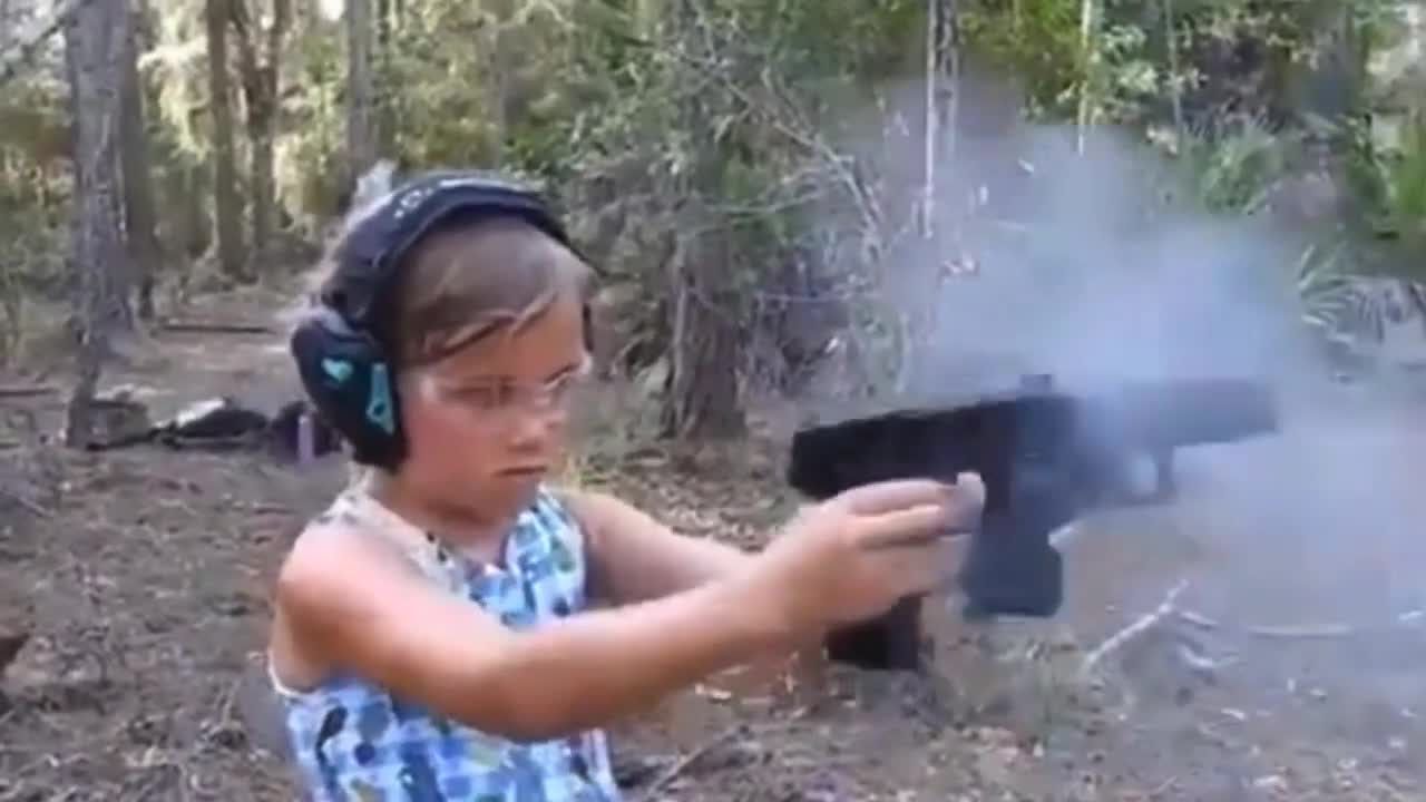 Young Girl Shoots Guns One in Each Hand