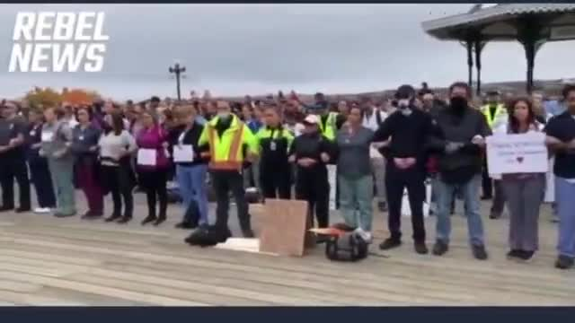 Canada. Quebec front line workers protest the mandatory FrankenVaxx (Quieter than Rememberance day)
