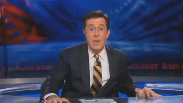 """Mocking us again... """"Comedian"""" Stephen Colbert Feeding a baby to the advversary"""